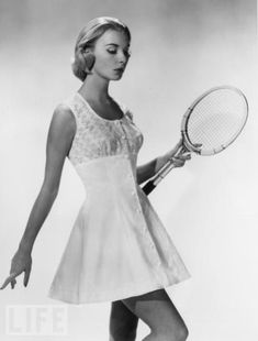 This is a vintage tennis dress which I think is beautiful. I don't know anyone currently on tour who could get away with wearing this and not look foolish in doing so ; ) She is so (ultra) feminine she honestly could wear lace (on court) and look perfectly in style and comfortable at the same time : )