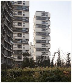 Vertical Housing in Hangzhou, China;  photo by Clement Guillaume, via Flickr