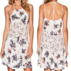 Free People Floral Dress New with tags!! Never worn , super cute Free People floral print dress. Very lightweight. 100% rayon. Free People Dresses Mini
