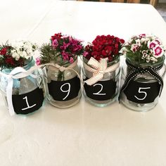 Use chalkboard numbers Table centre piece. Grandad 90th. Born in 1925. 90th birthday.
