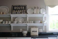 White on white kitchen with open  shelving