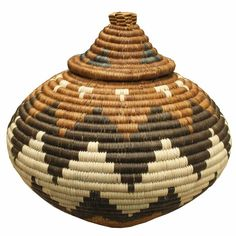 This brown, black and eggplant colored Zulu Ukhamba basket is approximately tall including the lid, and wide at its widest point. It includes a card containing detailed information on Zulu baskets as well as a picture of the weaver, Thulisile Nsele. Zulu, African Art, Traditional Art, Burberry, Baskets, Kitchen, Home Decor, Africa, Cooking
