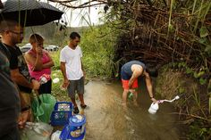 With most of the island having no running water, people are getting drinking water from mountain springs.