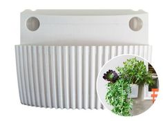 Living Wall Planter, Vertical Garden, Indoor/Outdoor Woolly Pocket (works indoors and outdoors) (Color: White) Living Wall Planter Vertical Garden (Modular, Sustainable, Recycleable) Hanging Wall Planter by Woolly Pocket. $26.99. Easy to hang. Modular. Self Watering. Made in USA. Eco-Friendly. All new Woolly Reimagined Living Wall Planter! The new modular design features a hard vented shell, a sturdy shape and is equipped with a self-watering tank, all designed to make pl...