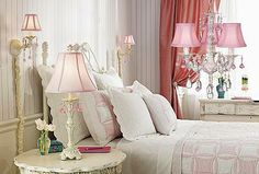 I love the simplicity of this bedroom without all the fussiness...very clean lines...love the pink touches...
