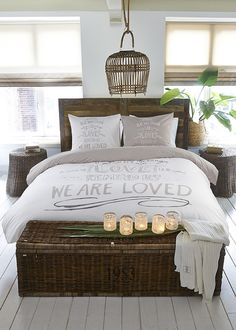 I like the head board and wicker basket at the foot of the bed