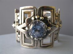 A sterling silver and glass mexican influenced bracelet.