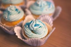 Frozen glitter cupcakes with blue topping
