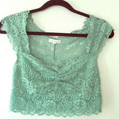 Turquoise beautiful lace crop top!! Turquoise Lace crop top. Size medium. In excellent condition. No holes, no rips Phanuel Tops Crop Tops