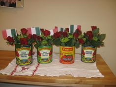 These colorful tomato cans are great vases for an Italian themed party...they make even spaghetti and meatballs festive