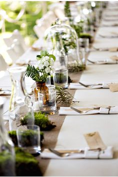 Jars, terrariums and plants perfect for a Beautiful Botanical Luxe wedding on @intimatewedding #botanical #intimatewedding #tablesettings
