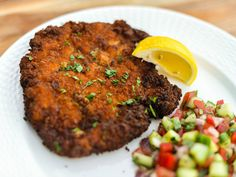 It's no coincidence that chicken schnitzel—pounded chicken breasts that are breaded and fried—is such a popular dish around the world: Perfectly cooked schnitzel, like the version here, is juicy and tender, with a golden, crunchy exterior that is almost impossible to resist.