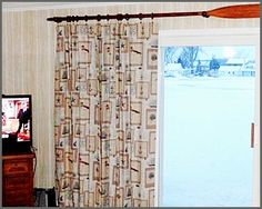Love the oar used to hang the curtains!