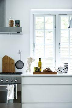 white modern kitchen with a big window