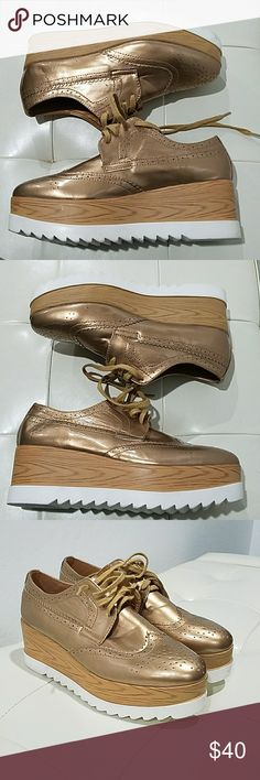 GOLD OXFORD PLATFORM.SHOES Super cute lace up patent leather shoes, size 10, made in China, all man-made materials, Rock these with confidence!!! Gold tone upper top,mid section corklike, bottom layer is white, run small. Shoes Platforms