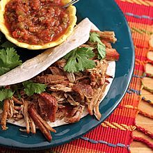 Carnitas Shredded Pork -- a low-fat, tasty recipe for use in tacos, burritos, enchiladas, & more (slow cooker and stove top methods)