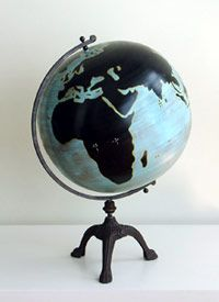 """Warner Globe                       An antiqued painted finish creates intrigue in this metal globe.  Standing nearly three feet tall on a cast iron stand, this globe will spark conversation while adding style to your home.    35"""" H x 20"""" Dia.                   $335.00"""