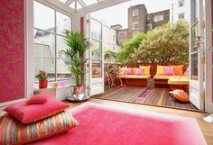 bright pink & orange room with patio