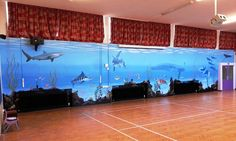 This underwater scene was painted in Crofton Infants School Hall. This was a very large wall and the mural really brightens up the area and makes it an inspiring and educational space. This took us two weeks to complete.