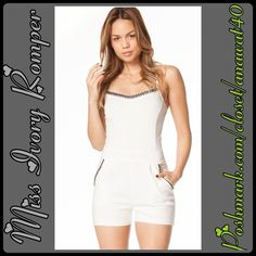 Miss Ivory Romper Miss Ivory Romper get your romper on! This footed romper features a beaded neck and side pocket trim , mesh rib detail , back zipper and adjustable straps. Paint the town in this perfect romper . Fabric: Cotton/Spandex Pants Jumpsuits & Rompers