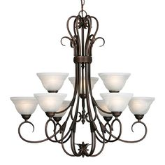 Rubbed bronze chandelier with handmade glass shades.  Product: ChandelierConstruction Material: Metal and glass