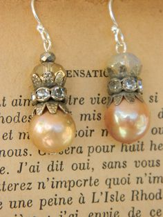PEARLS OF WISDOM assemblage earring french repurposed jewelry flameball lavender pink pearl by atelier paris on etsy by atelierparis on Etsy https://www.etsy.com/listing/254923220/pearls-of-wisdom-assemblage-earring