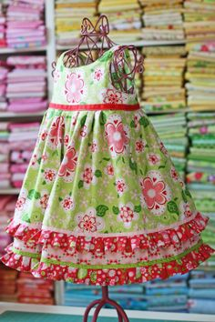 """""""Spring Lilly"""" This darling baby doll dress is made using my """"Lilly"""" pattern. In this one I used 3 darling prints in pinks, red. Toddler Dress, Toddler Outfits, Baby Dress, Kids Outfits, Little Girl Fashion, Kids Fashion, Little Girl Dresses, Girls Dresses, Dress Anak"""
