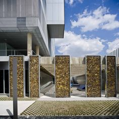 Pictures - Fuencarral-El Pardo Police Station - Architizer...love these gabions.