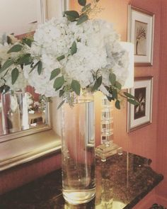 tall arrangement of white hydrangea, white roses, dusty miller and seeded eucalyptus made for a beautiful winter wedding Seeded Eucalyptus, Dusty Miller, White Roses, Hydrangea, Big Day, Wedding Events, Glass Vase, Floral Design, Seeds