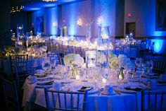 Nice mix of #blueuplighting and pin-spot lighting on the centerpieces. Get the look, http://RentUplights.com (Party Mix Wedding)