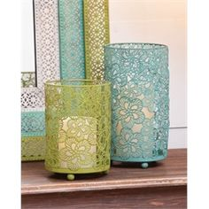 Blue and Green Pierced Floral Whimsically Designed Metal Candle Holders