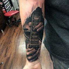 Playing the guitar tattoo - guitar arm tattoo on TattooChief.com