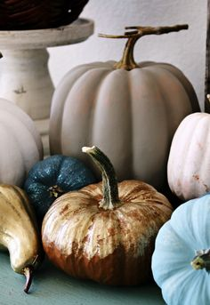 Neutralize It - Ditch the traditional orange and black color schemeand paint pumpkins in grays, whites, blues (or whatever matches your home decor) to make a statement this Halloween.