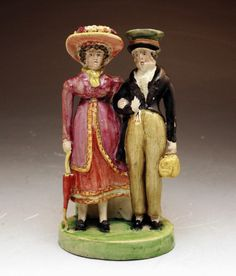 Staffordshire figure group of male and female Dandies.