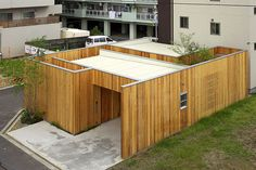 arbol design brings privacy and sunlight to house in nishimikuni