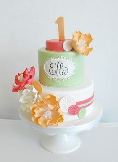 Ella 1st Birthday Cake by Anna Elizabeth Cakes, via Flickr  - Shades of coral, green, apricot, and white.