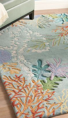 This beautiful coral reef rug is perfect for the land locked mermaid | 37 Subtle Ways To Bring The Ocean Into Your Home