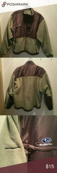 Fleece jacket with Subaru logo Olive green and grey fleece jacket with Subaru logo on front and Outback stitched into the sleve. Perfect for that Subaru lover in your life! Polyester and nylon blend. Toggle at base to tighten. Great condition,  smoke-free environment. Outer Boundry Jackets & Coats