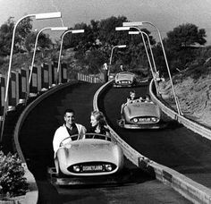 (ca. 1955)*#^ - A family enjoying the first generation Autopia ride at Disnelyand. These were gas powered go-karts that went about 6 mph. Fun for the kids; but not enough speed for a teenager or adult. More fun to bump the person in front of you if they stopped or slowed. Water and Power Associates
