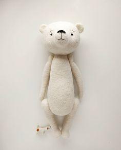 It's not that this dog is sooo tiny (well, ok...it is), it's my bear boy that's rather big.  #needlefelted #needlefeltedtoys #feltedteddy #handmadetoysofinstagram #handmadeteddy  #polarbear #handmadegifts #manomine