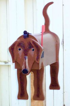 Dog mailbox - Handcrafted and hand painted animal mailboxes by artist Michel Devost in Quebec. If you would like to order a special mailbox, contact Michel at http://pages.globetrotter.net/miche/mailboxes.html
