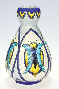 Boch Freres Art Pottery Crackled Enamel Vase, having oval panels each containing a large butterfly in blue, cobalt blue, black and yellow on a white  ground, circa 1901-1950