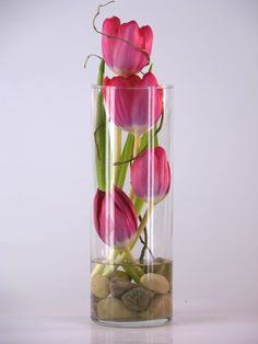 Tulip Tower - Tulips in a glass tower vase accented with river rocks, curly willow and bear grass. Fresh Flowers, Spring Flowers, Beautiful Flowers, Ikebana, Deco Floral, Floral Design, Flower Vases, Flower Art, Deco Table