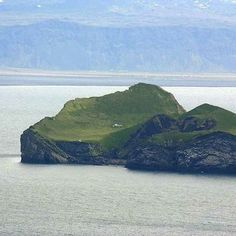 a hunting lodge—sits on an island in the remote Vestmannaeyjar archipelago off the south coast of Iceland.