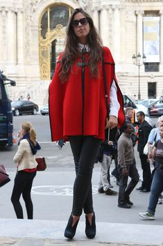 A red cape is one way to break up a basic look with a gorgeous, color-rich…