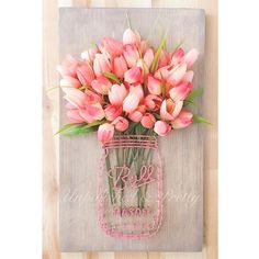 I finished up this order today and I love the coral!  Ordering recipe:  Large custom ball Mason jar string art Stain: cream wash walnut  String: coral Flowers: coral tulips  #originalmasonjarstringart  #homedecor #flowers #floraldecor #gallerywall