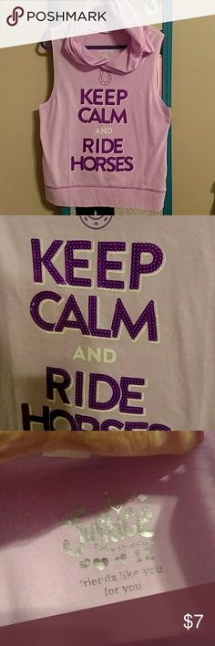 Justice Girls Top with Hood size 12 Sleeveless Pink cotton blend with purple sequins stating KEEP CALM AND RIDE HORSES.  On the back is a tiny hole where the tag was pulled out. Would not show and very mendable. Justice Shirts & Tops Tank Tops