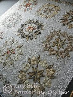 Oh my! Incredible quilting. Gold and bronze neutral colors. Love it! Quilts by FGFheadhonker