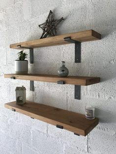 Please note - wide shelves are currently out of stockKiln dried/joinery grade oak boards. Planed and Sanded Solid, kiln-dried oak shelving With cast iron brackets Price includes free mainland UK delivery, a choice of protective oils and L-Shape brackets Oak Corner Shelf, Oak Wall Shelves, Modern Floating Shelves, Floating Shelves Bedroom, Wooden Shelves, Shelving, Kitchen Shelves, Oak Beam Fireplace, Fireplace Shelves