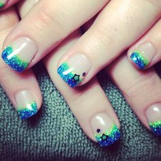 Blue and green glitter acrylic nails with black stars